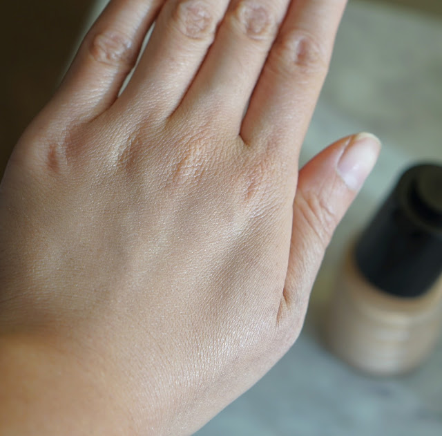 shu uemura lightbulb essence foundation review swatch blended medium light sand